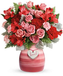 """Playful pink roses and radiant red blooms look oh-so wonderful in this hand-painted ceramic vase, adorned with a charming """"loved"""" heart charm."""